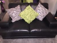 Black leather 2 seater and 3 seater suite just over 1 year old excellent condition