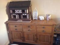 Solid oak sideboard, selling due to moving great condition also has matching side table if wanted