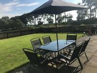 Garden table and chairs with parasol