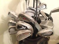 Job lot of mixed golf clubs and bags