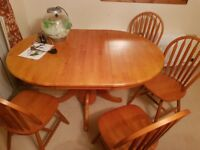 Pine extending dining table with 4 chairs. Lovely condition.