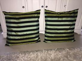2 green and black cushions