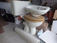 Toilet and small 45cm wash hand basin