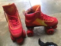 Roller skates size 5; four wheel with protective wear & bag