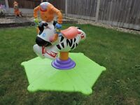 fisher price bounce and spin zebra with music