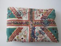 Vintage style embroidered cushion