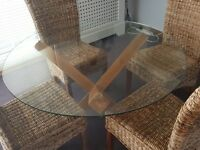 Glass dining table and 4 wicker chairs