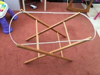 Moses basket, two stands and sheets/blankets
