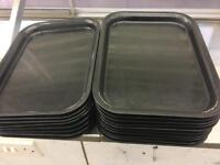 Stainless steel and Black plastic trays .
