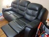 2 x 3 seater faux leather sofas in black in excellent condition