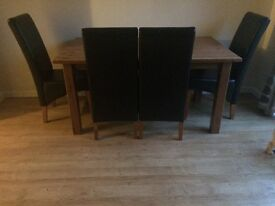 wood dining table faux leather chairs