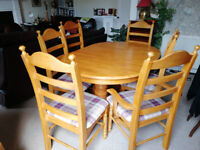 Solid pine extending table and six chairs in excellent condition.