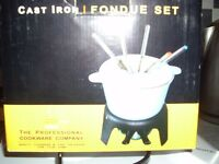 Cast Iron fondue set never been used