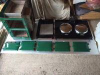 Gas fired four oven Aga in green. Fully dismantled and ready for inspection.