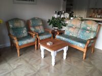 Compact 3 piece suite for conservatory or garden room with pine frame and green cushions