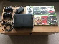 X-Box 360 with controls & 7 games.