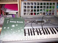 Yamaha PSR-275 Keyboard. With stand, mains adapter and books.