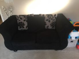 Black 2 seater and 3 seater sofa with storage pouf
