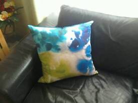 Two harlequin mirage designer feather filled cushions