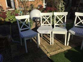 4 white IKEA dinning chairs with covers £60
