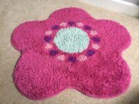 Flower shaped rug, pink/aqua/purple, good condition, 70cm diameter