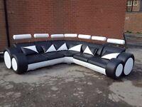 Fantastic large black and white leather corner sofa.Superb modern design. 1 month old. can deliver