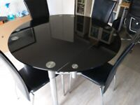 Glass extendable dining table and 4 chairs