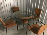Glass top table and four chairs as seen for sale