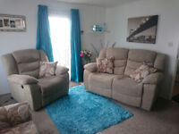 2 Seater sofa and armchair with electric recliners on all seats. 6month old