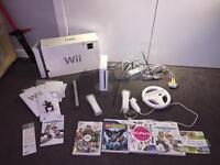 Wii console with games controllers complete with Instructions