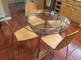 REDUCED FOR QUICK SALE Glass dining table and 4 chairs for sale
