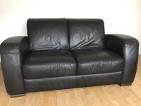 "Two x Genuine ""Natuzzi"" Black Leather 2-seater Sofas (Suite)"