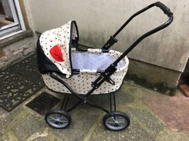 Mini pram, Handle height 55cm. Folding shade. Folds flat for storage, from age 3+,