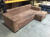 Two seat sofa piece with a corner piece