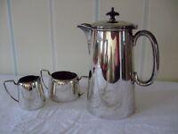 Silver plated coffee pot, sugar bowl and cream jug