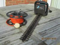 Black and Decker corded hedge trimmer.