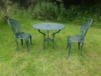 Green metal garden table and 2 chairs