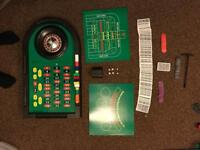 Gambling set with chips, cards, dice and sweeper