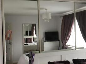 Floor to ceiling sliding wardrobe mirrored doors