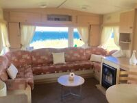 CHEAP STATIC CARAVAN FOR SALE ON FRONT ROW SEA VIEW PITCH BREATH TAKING VIEWS LOW DEPOSIT
