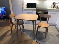 Made Fjord Compact Dining Table with two Fjord chairs