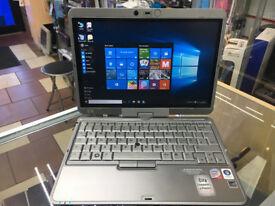 FAST NETBOOK LAPTOP/ WINDOWS 10 HP COMPAQ 2710P LAPTOP/ 3GB RAM. TOUCH SCREEN