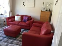 Red curved Italian leather sofas x 2 + footstool