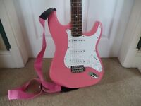 Pink electric guitar with combo amplifier and case. Loughborough Leicestershire