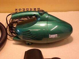 Handy green hand held vacuum cleaner