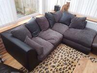 Faux black leather/grey fabric corner sofa.