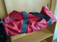 Red holdall