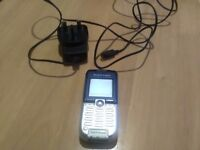 Sony Ericsson mobile phone with charger