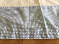 Light blue tab top curtains with black out blind lining