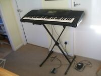 Yamaha PSR-620 5-octave keyboard with stand and sustain pedal